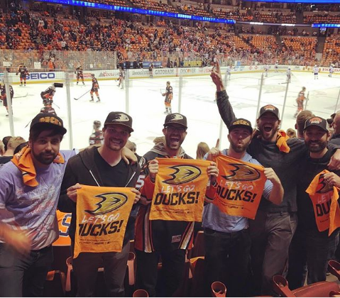 Tyler Hoechlin at a Ducks hockey game with friends