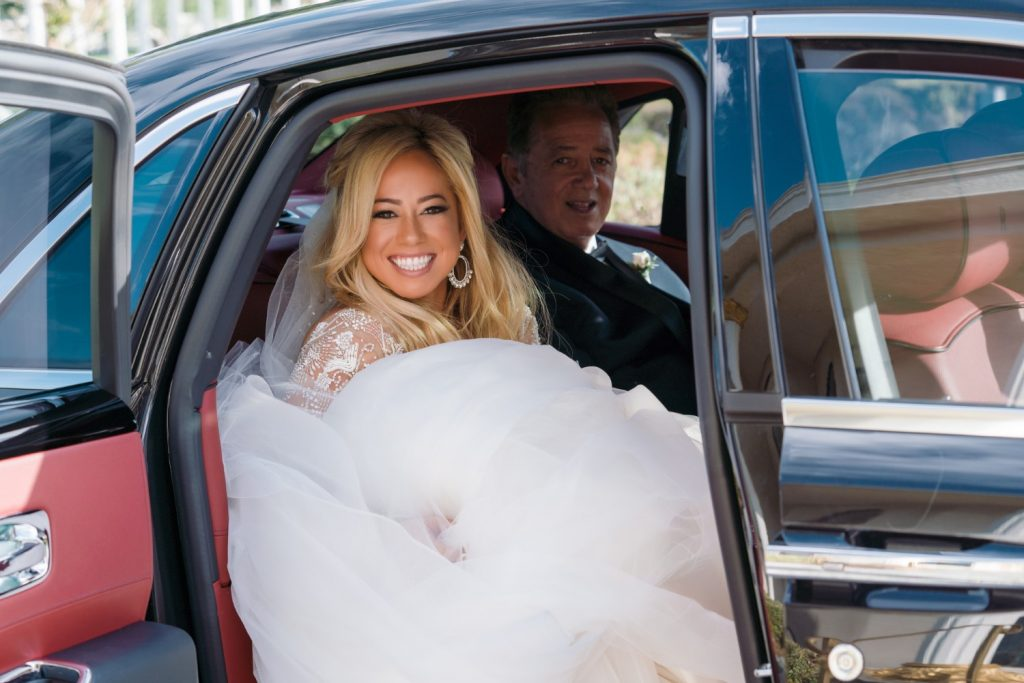 Sabrina Bryan in the car with her father on her wedding day