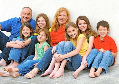 Joshua Bassett with his parents and 5 sisters