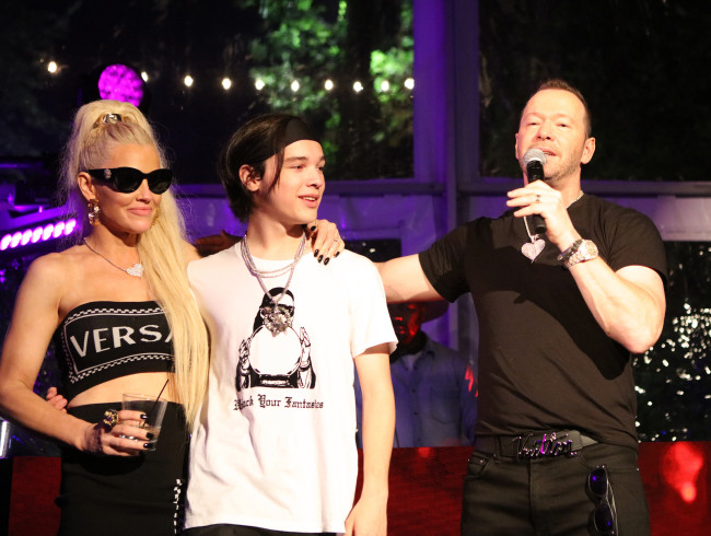 Jenny McCarthy, Elijah and Donnie Wahlberg at his 50th Birthday