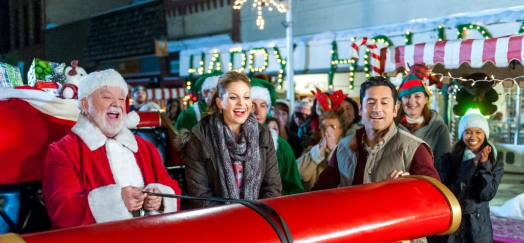 Scarf and red plaid shirt in 'Christmas Under Wraps' on Candace Cameron Bure