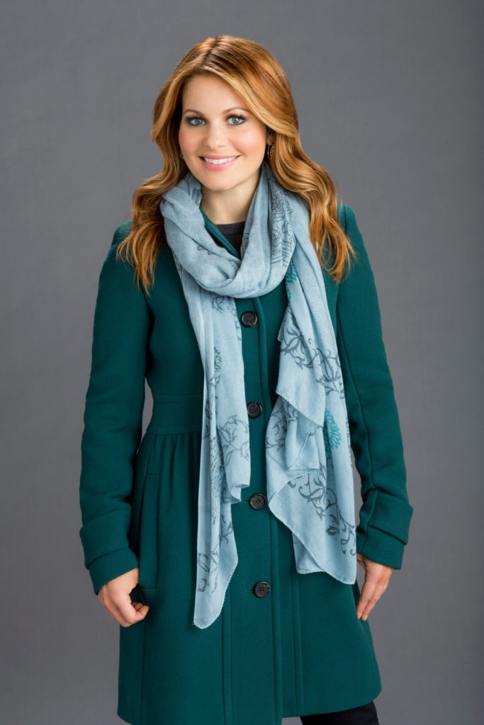 Teal winter jacket on Candace Cameron for Christmas Under Wraps
