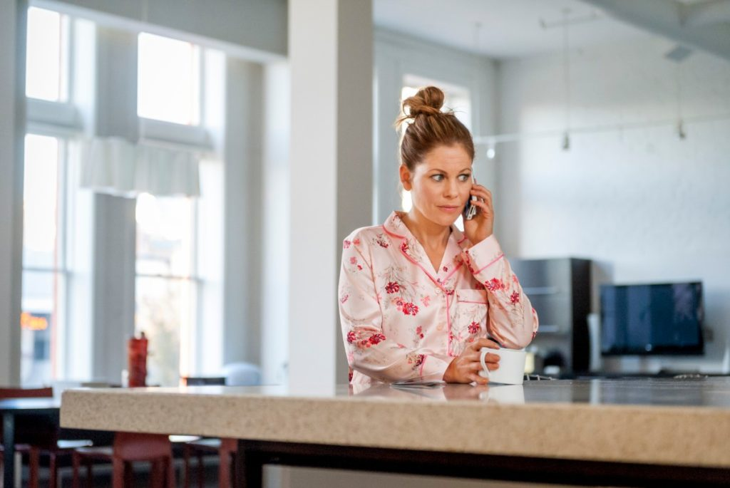 Pink flowered pajamas on Candace Cameron Bure in Christmas Under Wraps