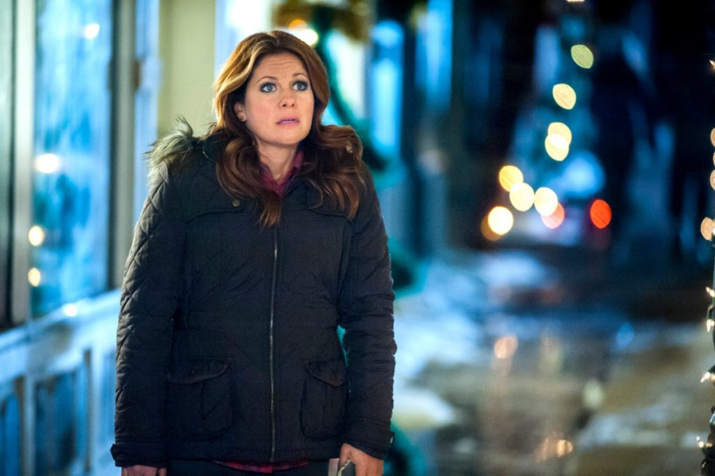 Dark gray winter coat on Candace Cameron Bure in Christmas Under Wraps
