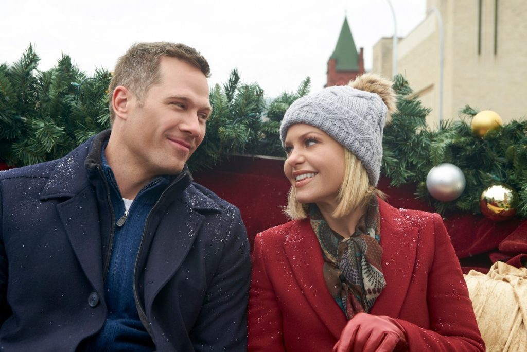Candace Cameron's red coat, silver hat and red gloves from A Shoe Addict's Christmas