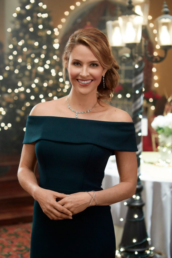 Jill Wagner's green off the shoulder dress from Christmas Wishes & Mistletoe Kisses