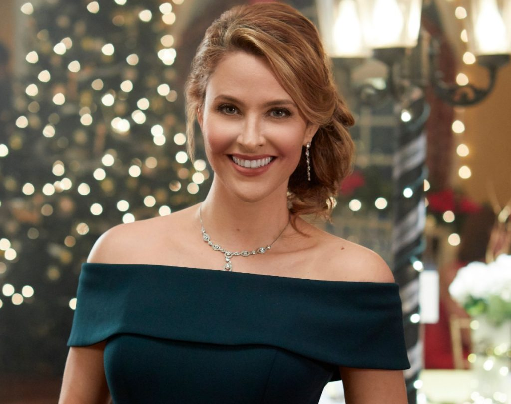 Jill Wagner Green off the shoulder dress from Christmas Wishes & Mistletoe Kisses