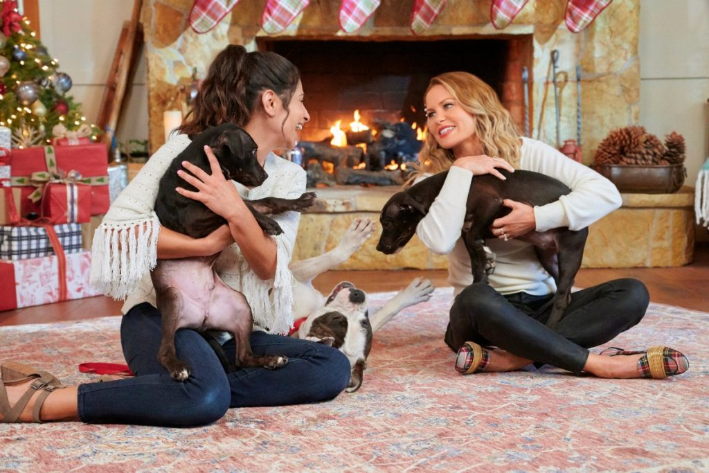 Larissa Wohl and Candace Cameron Bure in Countdown to Christmas Special - Get their clothes inside.