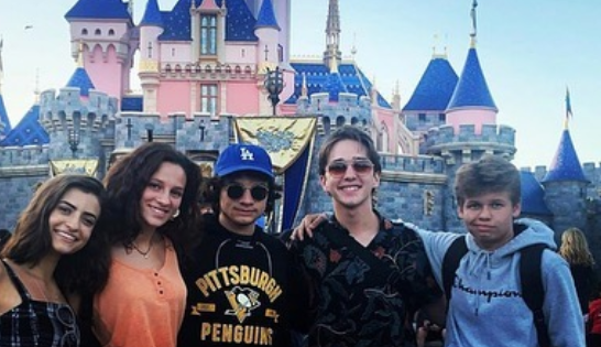 Andrea Barber's son Tate at Disney with Michael Campion and Soni Nicole