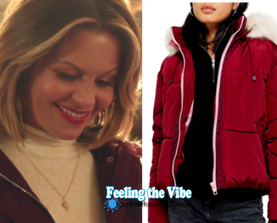 Candace Cameron Bure in a red parka jacket for Christmas Town